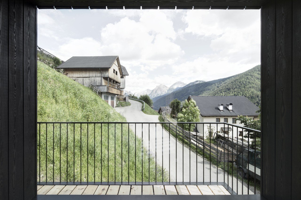 The loggia-inspired balcony, a fixture of the region's architecture, protects guests from harsh winds.  Photo 4 of 13 in Find Sanctuary in This Chalet in the Italian Alps