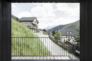 Find Sanctuary in This Chalet in the Italian Alps - Photo 3 of 12 - The loggia-inspired balcony, a fixture of the region's architecture, protects guests from harsh winds.