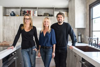 """Chef Ludo Lefebvre's Modern Kitchen With Rustic Roots - Photo 2 of 7 - Krissy Lefebvre, left, and Ludo Lefebvre, right, pose in the redone kitchen with their designer Ginny Capo, who is based in Santa Monica. """"Ginny did a great job of marrying modern appliances with old world materials to give us a perfectly balanced, updated, and truly functional space,"""" says Lefebvre."""