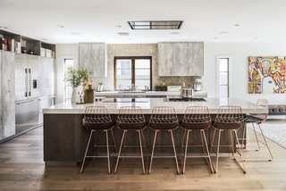 One of the elements that Lefebvre had his heart set on was a copper sink, though it didn't go along with the rest of the decor; the copper bar stools by Bend Goods were a serendipitous find that tied the room together.