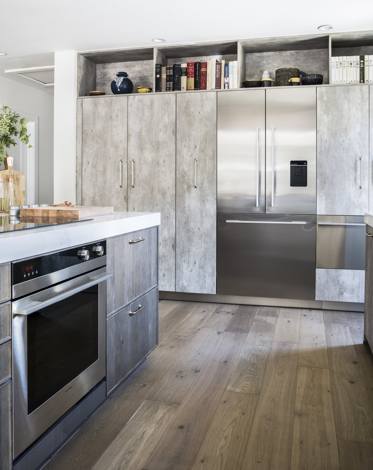 The Built-In French Door Refrigerator by Fisher & Paykel is seamlessly integrated with the kitchen cabinetry. ActiveSmart Foodcare monitors how the family uses the fridge to maintain a controlled climate and keep food fresh. Beside the fridge, the CoolDrawer provides flexibility with 5 temperature settings: freezer, chill, fridge, pantry, and wine modes.