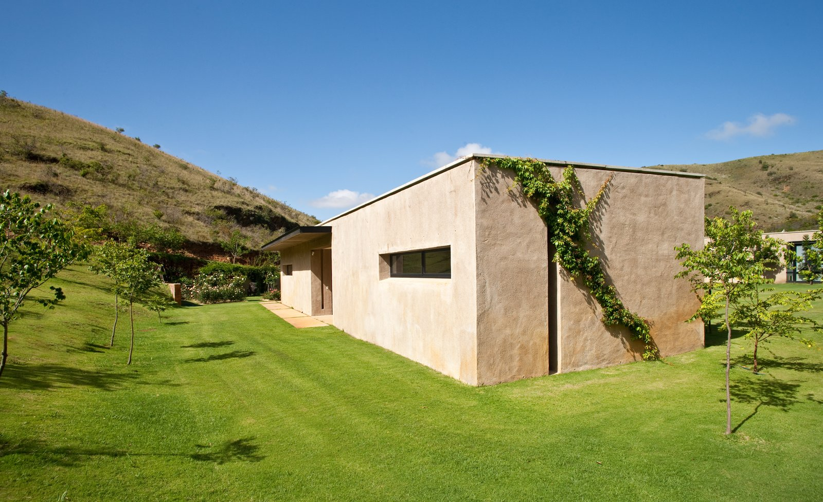 Tagged: Outdoor, Side Yard, Trees, Grass, Shrubs, and Slope.  Photo 9 of 10 in This South African Villa Lets You Bask in Divine Views