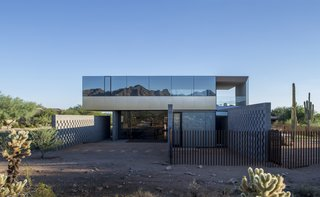 This Sleek Desert Home Seems to Melt Into the Sky - Photo 1 of 12 - Designed bySzu-Ping Patricia Chen Suchart and Thamarit Suchart of Chen + Suchart Studio, the Staab residence stands in stark contrast to its suburban context but in harmony with the Sonoran Desert.