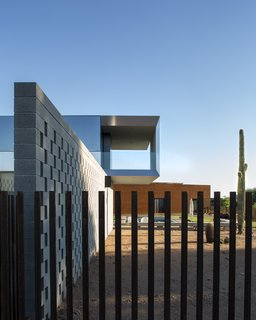 This Sleek Desert Home Seems to Melt Into the Sky - Photo 10 of 12 - The client is a motorcycle enthusiast and keeps his equipment in the garage, which is clad in weathering steel and acts as a southern wall.