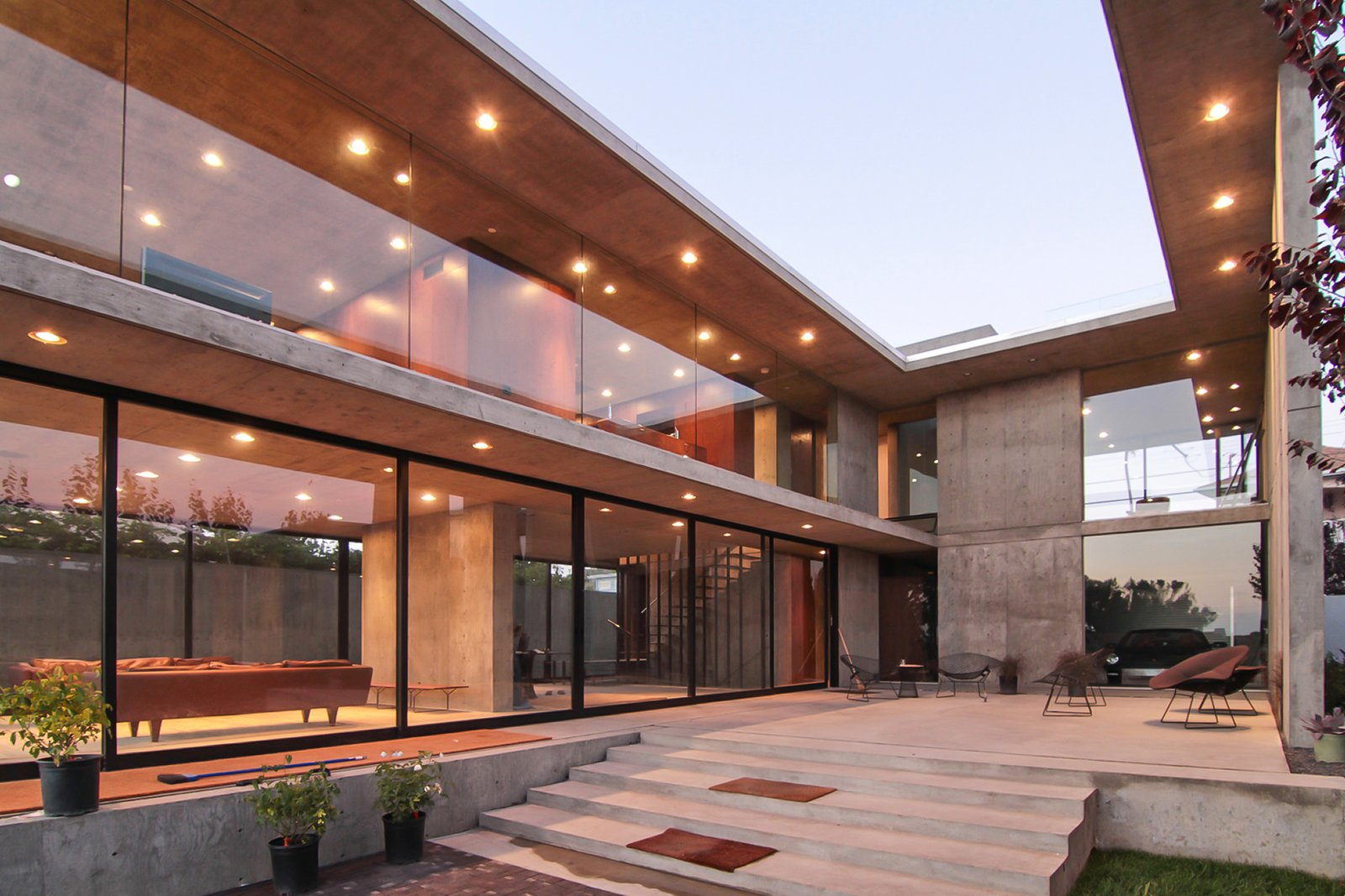 Several factors allow the house to depend nearly wholly on the solar array on the roof for power: windows that completely open for cross ventilation, the thermal mass of concrete, sun shading, and the pool's insulating effect. This Architect's Home Embraces Oceanfront Views - Photo 4 of 8