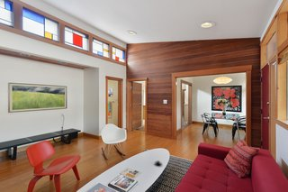 Artists Need Apply: This Midcentury Home Comes With an All-Purpose Workshop for $949K - Photo 2 of 11 - Clerestory windows, outfitted with stained glass in the living room, allow light to bathe nearly every room.