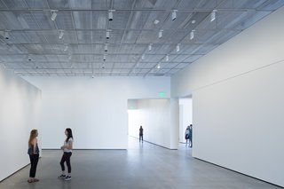 A Game-Changing Museum Becomes a New Symbol of UC Davis - Photo 6 of 7 - The exhibition spaces have polished concrete floors and custom aluminum mesh ceilings that are fitted with occupant-controlled LED lights. The museum is on course to be LEED-certified.