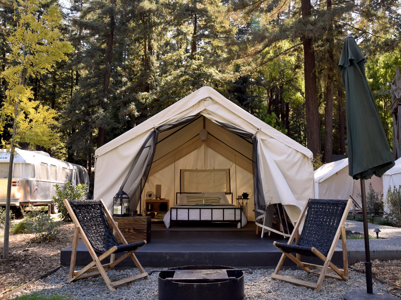 Outside each tent is a patio area outfitted with lounge chairs and a fire pit. At night, an electric blanket keeps things toasty.  Photo 8 of 11 in At AutoCamp, Sleep in a Slice of Americana for $225 a Night