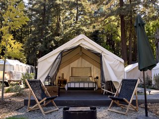 At AutoCamp, Sleep in a Slice of Americana for $225 a Night - Photo 7 of 10 - Outside each tent is a patio area outfitted with lounge chairs and a fire pit. At night, an electric blanket keeps things toasty.