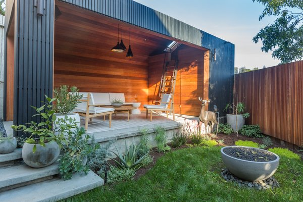 An architect and designer couple rescued their partly-sunken home and transformed a dilapidated garage into a modern living room.