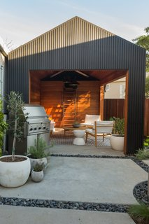 25 Blissful Backyards - Photo 23 of 25 - Awkwardly shaped and saddled with a run-down garage, the backyard posed a challenge. Since the city wouldn't allow for the removal of the garage, Wendi and Lukas decided to convert it into additional living space.
