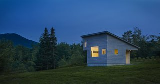 A Mini-Home With Mega-Views - Photo 4 of 4 - Built to stay cozy through all kinds of weather, Micro House has a gray-stained, cedar rain screen in addition to Lo-E glass. At a diagonal from the front porch, another subtracted corner makes space for a sleeping loft.