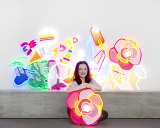 Next-Generation Neon - Photo 1 of 7 - Natalie Jarvis poses with her creations. When she initially conceived of Electric Confetti, she had considered using traditional neon, but its fragility and the presence of mercury drove her to research other alternatives—leading to her discovery of LED neon flex.