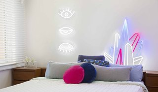Next-Generation Neon - Photo 3 of 7 - Eye! Eye! Eye! ($449) and Crystal Prism ($449) decorate a bedroom. Electric Confetti's designs come with a remote control that allows you to dim the neon to less than 5% brightness, ideal for a nightlight, or set it to an adjustable flashing speed.