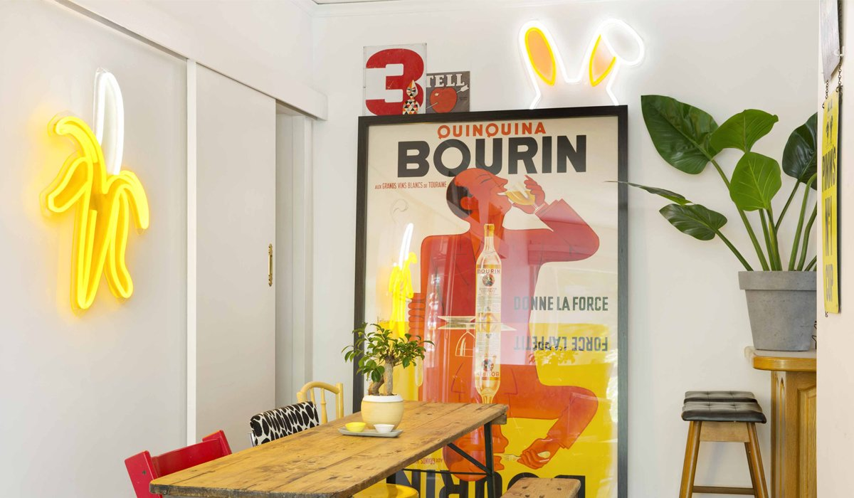 LED neon flex is a string of LED lights encased in PVC, making it durable, flexible, and more energy efficient. Above, a banana ($895) designed in collaboration with Kip & Co hangs alongside What's Up? ($300) bunny ears.  Photo 3 of 8 in Next-Generation Neon