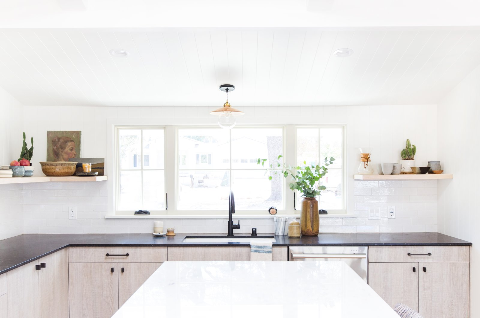 """A white undermount sink and a matte black faucet are functional, refined elements.  Photo 7 of 9 in The Big Reveal: An Interior Designer Unveils Her """"No Ordinary Kitchen"""" Makeover"""