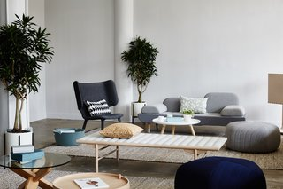 The Tembo Lounge Chair by New Works and an EJ 123 Toward Sofa by Erik Jorgensen lend their sculptural presence to the lounge area, while textiles by Ferm Living and Five Poufs by Muuto provide a counterbalancing softness. The glass-top Ding Table is by Normann Cophagen, and the Align Daybed is by Menu.