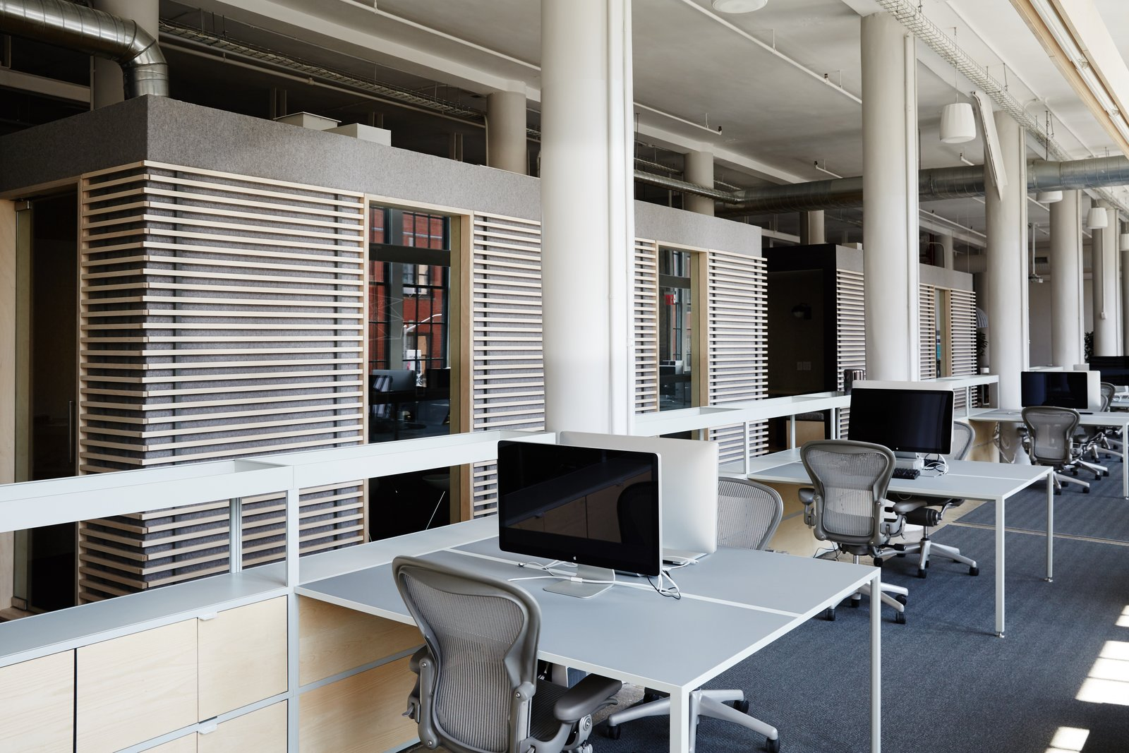 A HAY New Order desk system furnishes the workspace.