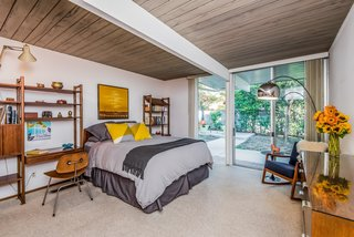 With Only One Previous Set of Owners, a Pristine Eichler Home Asks $799K - Photo 11 of 12 - The master bedroom enjoys a spacious walk-in closet and opens to the backyard.