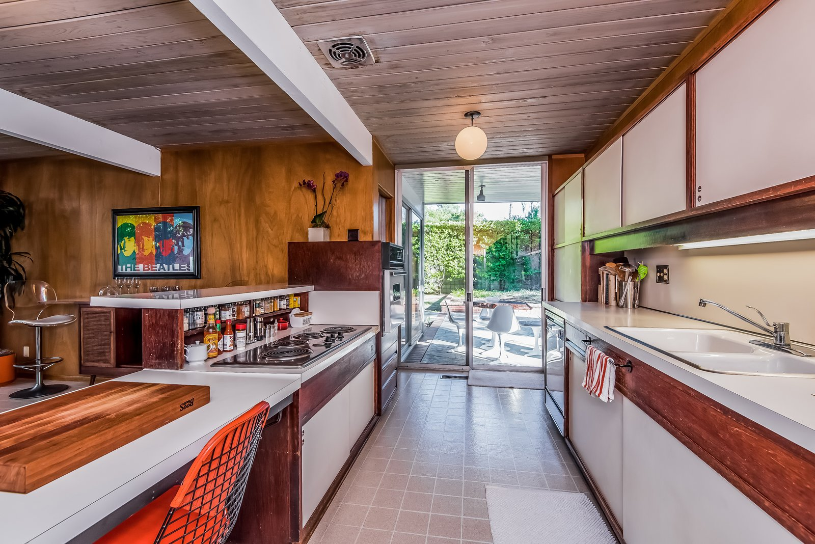 The same patio leads to the all-original kitchen...
