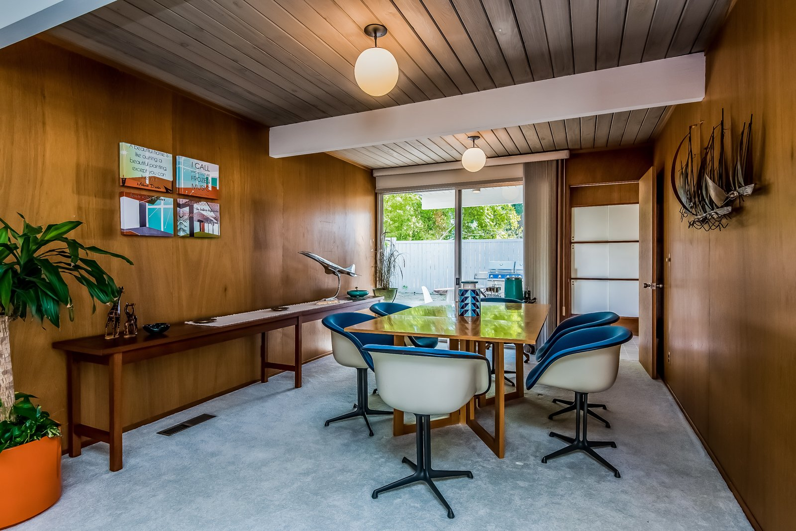 The living room flows into the dining room, which has access to a small covered patio.  Photo 7 of 13 in With Only One Previous Set of Owners, a Pristine Eichler Home Asks $799K
