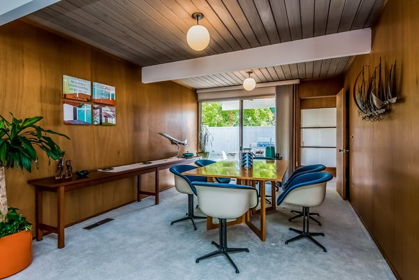 The living room flows into the dining room, which has access to a small covered patio.