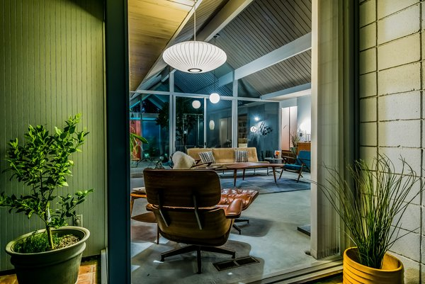 """An original Eames Chair Lounge and Ottoman complete the midcentury setting. Shares Guinto, """"Larry, before he passed, was such a great resource for the new homeowners in the Balboa Highlands neighborhood. When I sold another Eichler home on Lisette [Street], I was door-knocking the neighborhood to keep them in the know, and I remember Larry eagerly inviting me in to show me around. Even from his wheelchair and impaired mobility, you could see the enthusiasm he had for his home—which is the beauty with these one-story pieces of art. True pride of ownership."""""""