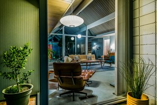 "With Only One Previous Set of Owners, a Pristine Eichler Home Asks $799K - Photo 5 of 12 - An original Eames Chair Lounge and Ottoman complete the midcentury setting. Shares Guinto, ""Larry, before he passed, was such a great resource for the new homeowners in the Balboa Highlands neighborhood. When I sold another Eichler home on Lisette [Street], I was door-knocking the neighborhood to keep them in the know, and I remember Larry eagerly inviting me in to show me around. Even from his wheelchair and impaired mobility, you could see the enthusiasm he had for his home—which is the beauty with these one-story pieces of art. True pride of ownership."""