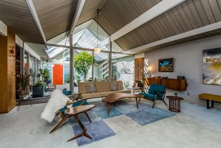 With Only One Previous Set of Owners, a Pristine Eichler Home Asks $799K - Photo 3 of 12 - Original tongue-and-groove ceilings and Philippine mahogany paneling grace the interior.