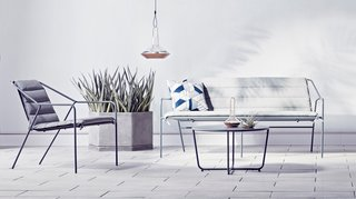 The Dwell x Target Lookbook Reveals a Sleek New Collection for the Modern Home - Photo 9 of 9 - Copper lanterns ($34.99 for the large) add metallic accents to an outdoor setting. The Outdoor Sofa in gray, $399.99, gets an extra layer of comfort with the Sofa Cushion in gray, $109.99.