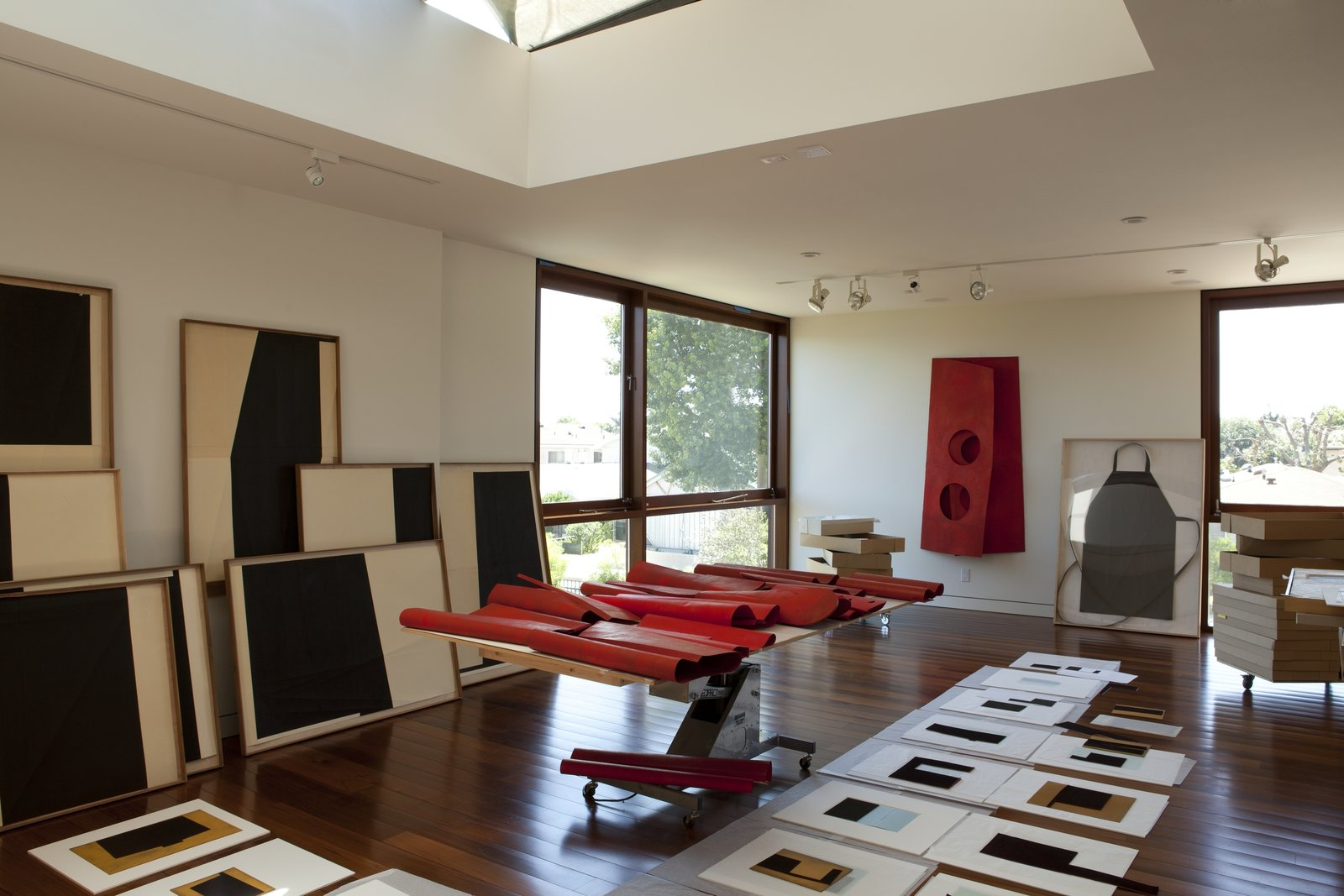 Studio space abounds on the property. The lot is zoned R2, requiring that the two living units have a total of four parking spaces, and the garage can also be converted into an art studio. Live Outside the Box in This Artist's Haven For $3.5M - Photo 8 of 9