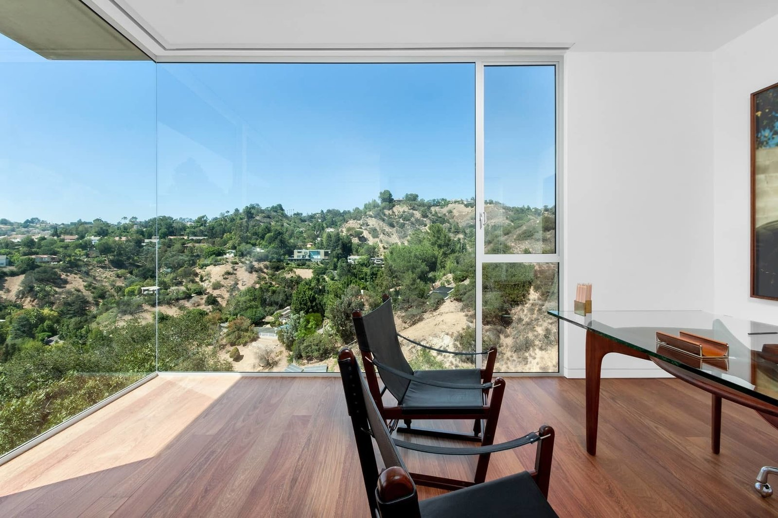 The guest bedroom, shown here as an office, offers an uninterrupted view of the surrounding canyon.