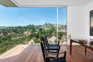 "A Celeb-Worthy Home in Beverly Hills Asks $6.75M - Photo 8 of 9 - The guest bedroom, shown here as an office, offers an uninterrupted view of the surrounding canyon. ""Walking into the space, it's just breathtaking,"" says JB Fung, agent and director of Aaroe Architectural."