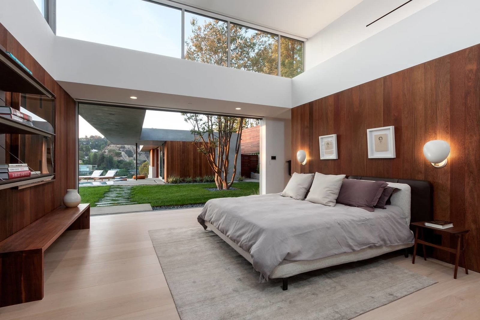 The master bedroom also has seamless outdoor access. The covered breezeway leads to the guest house, comprised of its own living space, kitchen, and bedroom, currently being used as an office.