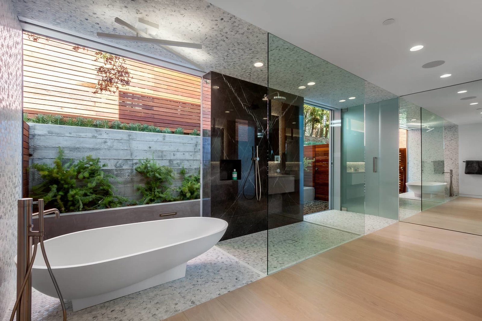 An Agape Spoon bathtub by Benedini Associati provides a sculptural focus in the master bathroom, which has sliding glass doors that open to a private garden area. A Celeb-Worthy Home in Beverly Hills Asks $7.4M - Photo 7 of 10
