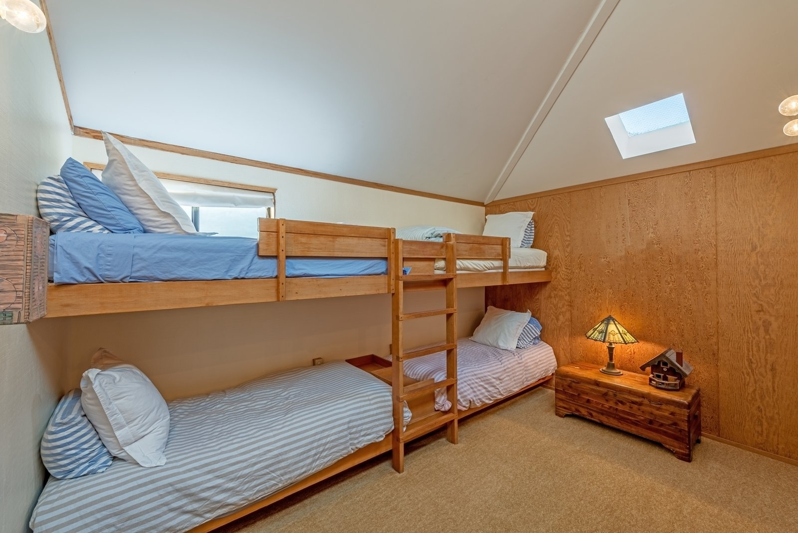 A bunk room in the guest wing sleeps four, ideal for family reunions or bigger groups.  Photo 10 of 12 in Settle in the Celebrated Sea Ranch For Under $2.9M