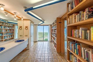 Settle in the Celebrated Sea Ranch For Under $2.9M - Photo 10 of 11 - In keeping with Moore's whimsical design sense, a guest bathroom has its own library.