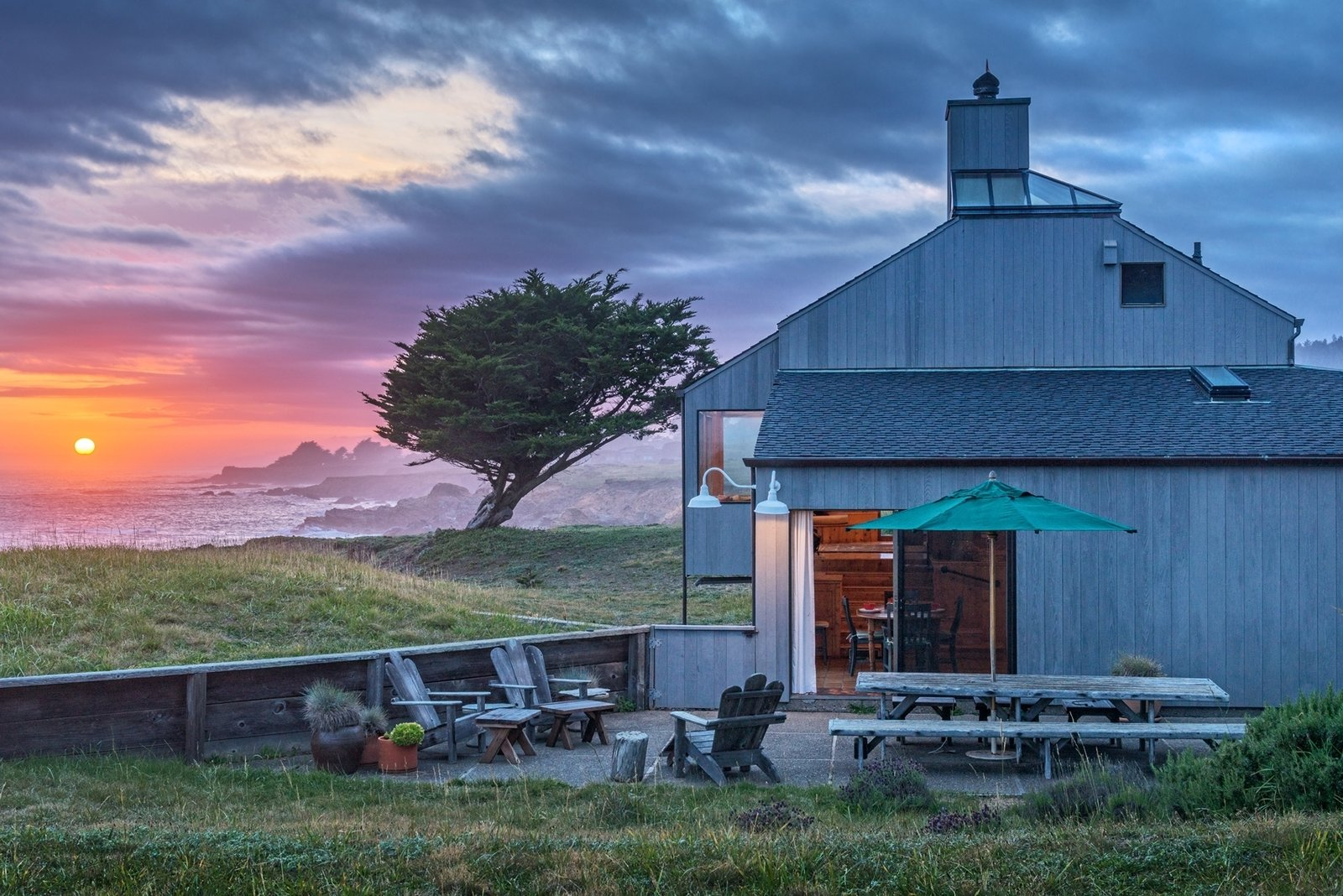 An outdoor patio provides the perfect setting for morning coffee or a summer get-together. The trail that connects the Sea Ranch community runs behind the house, lending it more privacy in comparison with other buildings.  Photo 9 of 12 in Settle in the Celebrated Sea Ranch For Under $2.9M