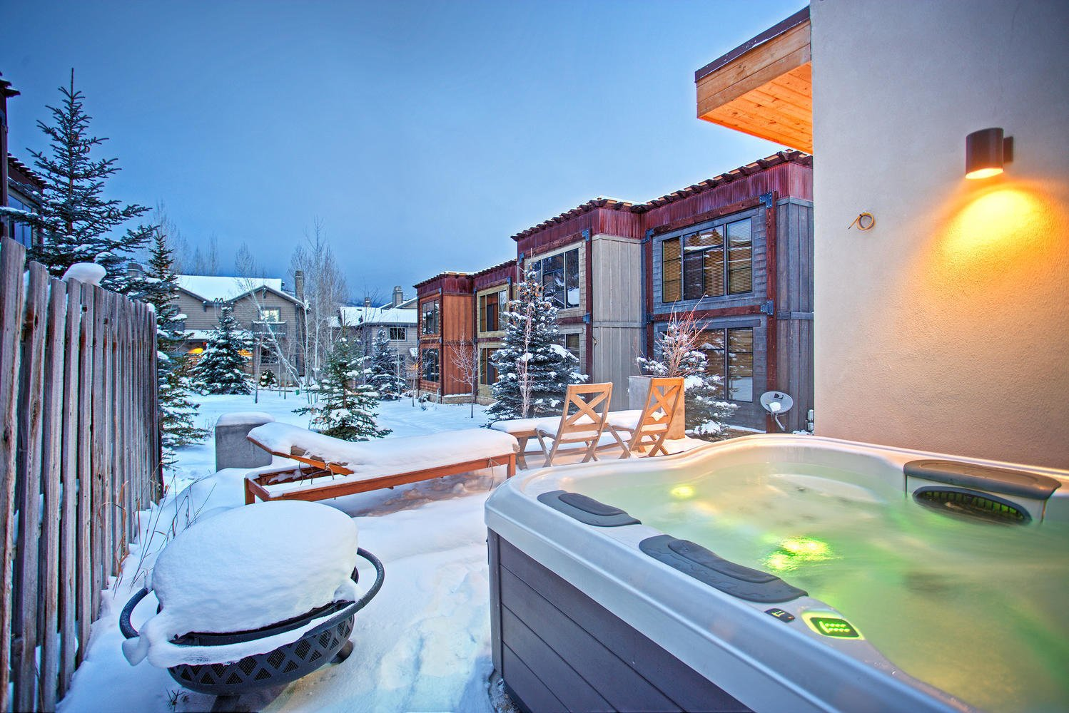 The lower deck holds a fire pit and hot tub, perfect for outdoor entertaining despite the cold.  Photo 3 of 9 in Be at Home With Park City's Slopes For $1.6M