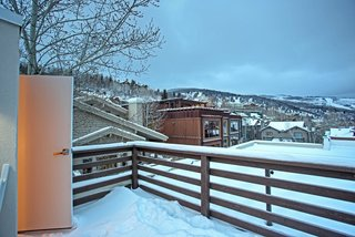 "Be at Home With Park City's Slopes For $1.6M - Photo 8 of 8 - The master bedroom enjoys access to the upper deck. ""It's tough to beat the rooftop view,"" says Preston. ""It almost rises above the surrounding neighborhood."""