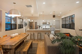 "Be at Home With Park City's Slopes For $1.6M - Photo 3 of 8 - Preston and his friends at Icon Homes opted for an open floor plan that integrates the living, dining, and kitchen areas. ""We went for a monochromatic look,"" says Preston. White oak plank flooring runs throughout the entire home."