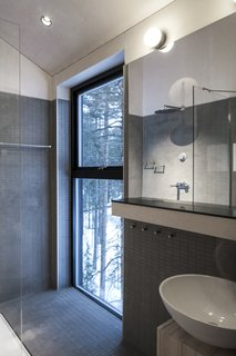 Go Stargazing in Snøhetta's Towering Addition to Sweden's Treehotel - Photo 6 of 7 - A bathroom and shower overlooks the surrounding forest.