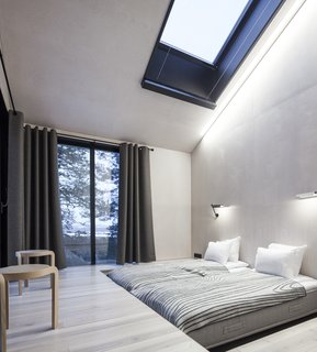 Go Stargazing in Snøhetta's Towering Addition to Sweden's Treehotel - Photo 5 of 7 - The bedrooms are placed on opposite ends of the cabin, each equipped with sliding doors that lead to the netted terrace. Above, skylights offer additional views of the stars.