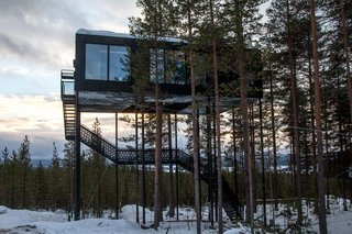 Go Stargazing in Snøhetta's Towering Addition to Sweden's Treehotel - Photo 7 of 7 - Guests ascend a staircase into the cabin, while a small lift carries up their luggage.