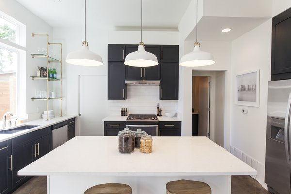 """I definitely wanted to give buyers a real sense of Austin,"" says Rios of the kitchen. ""We have such beautiful restaurants and super unique design in our city. I feel like the shelving, high vent hood, gas stove, and double-stacked cabinets really expand on the volume of the home."""