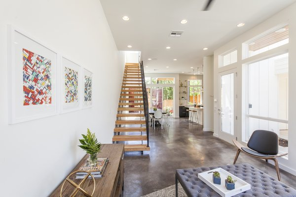 "A stained concrete floor gleams throughout the first floor. ""The staircase is a real showstopper,"" says Rios, ""connecting to the industrial steel of the containers, but warmed by wooden beams."""