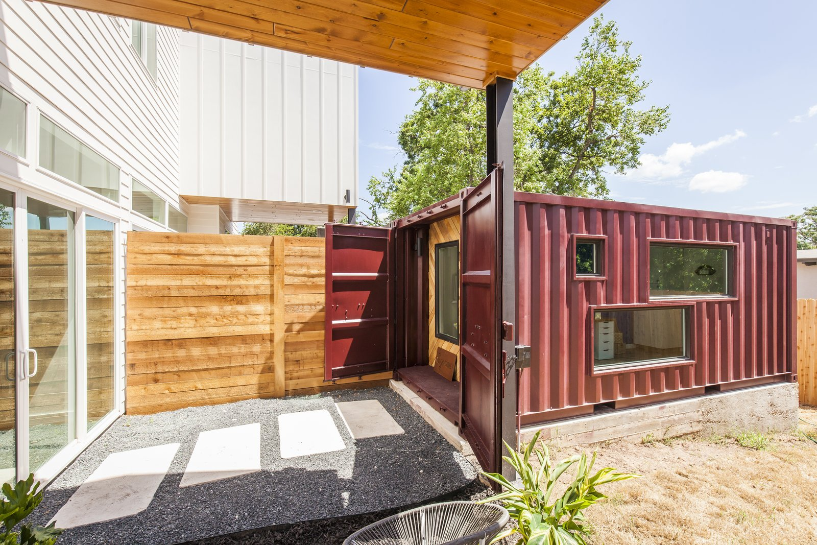 The two units in the duplex share a wall in the main house, so Rios continued the mirrored effect by placing the shipping containers side by side about 10 feet away from the home. Cut into the sides, the windows allow natural light to illuminate the shipping container and are designed to give parents a view of the kids playing in the backyard.  Photo 8 of 10 in Ship Shape: An Austin Home With a Shipping Container Addition Asks $499K