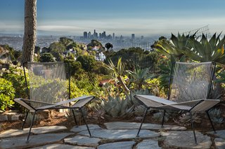 """Find Seclusion in the City With This $2.5M Lloyd Wright Residence - Photo 6 of 7 - """"Because the glass house is located on a ridge 40 feet above the street, it overlooks all the views yet is completely private,"""" says Powell."""