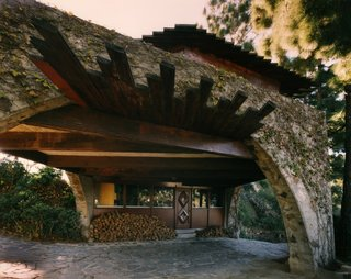 Find Seclusion in the City With This $2.5M Lloyd Wright Residence - Photo 7 of 7 - An office space is tucked under the arch spanning the driveway.