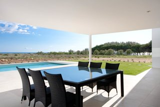 The outdoor patio provides an al fresco setting for entertaining by the pool.